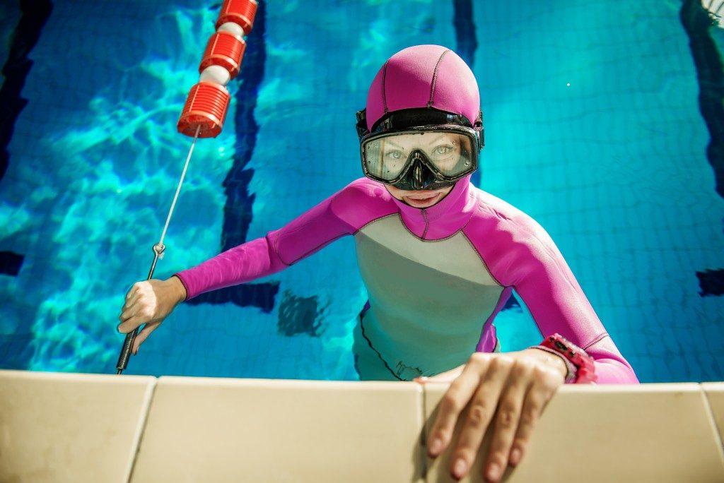 girl on edge of swimming pool