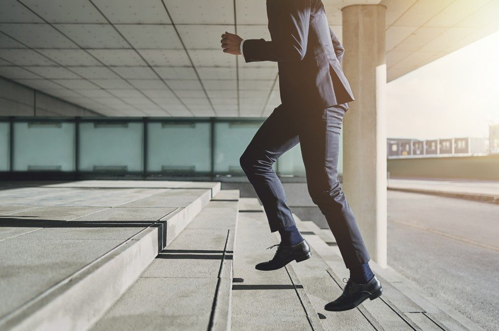 Man climbing stairs in corporate attire