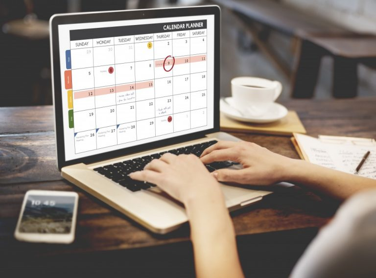 woman plotting events on the calendar