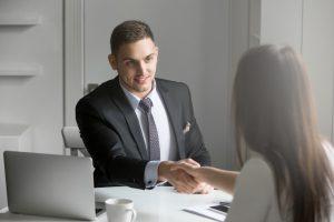Man shaking hand of HR