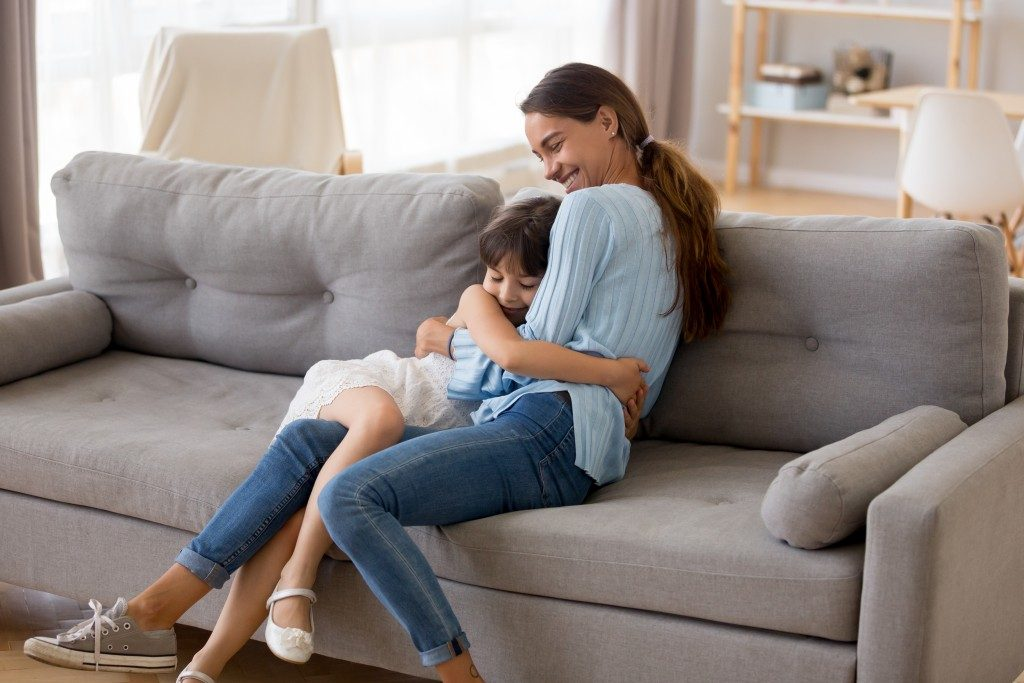 Mother and child on couch