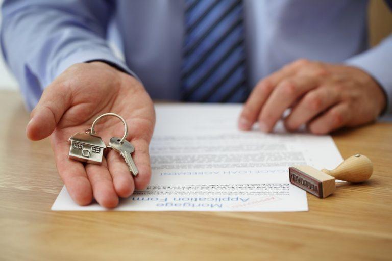 man handing over house keys