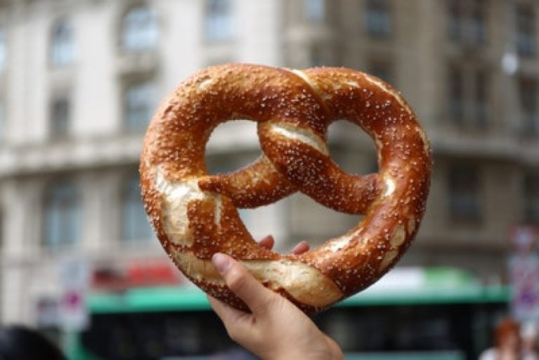 person holding a pretzel