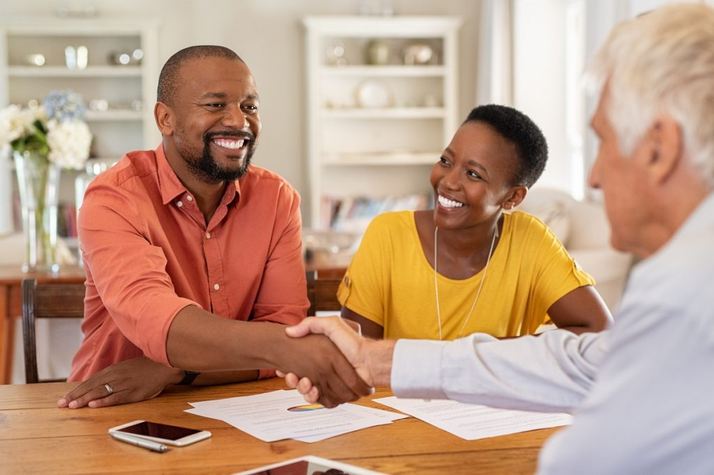Man shaking hands with insurance agent
