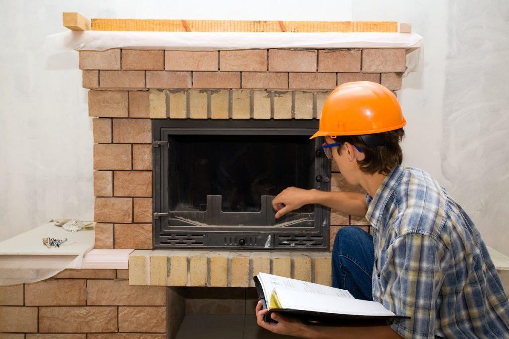 Man examines chimney