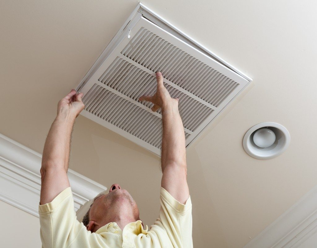 man checking the air duct