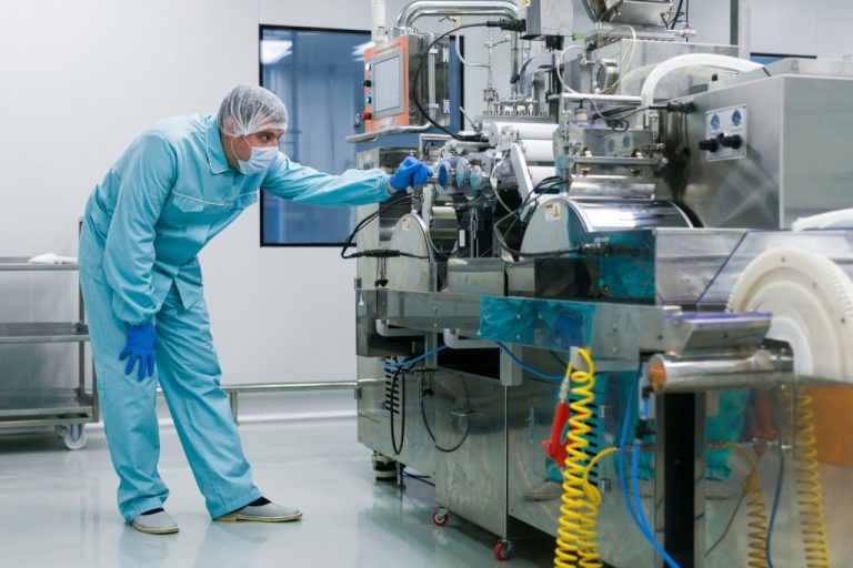 man checking the food-processing machine