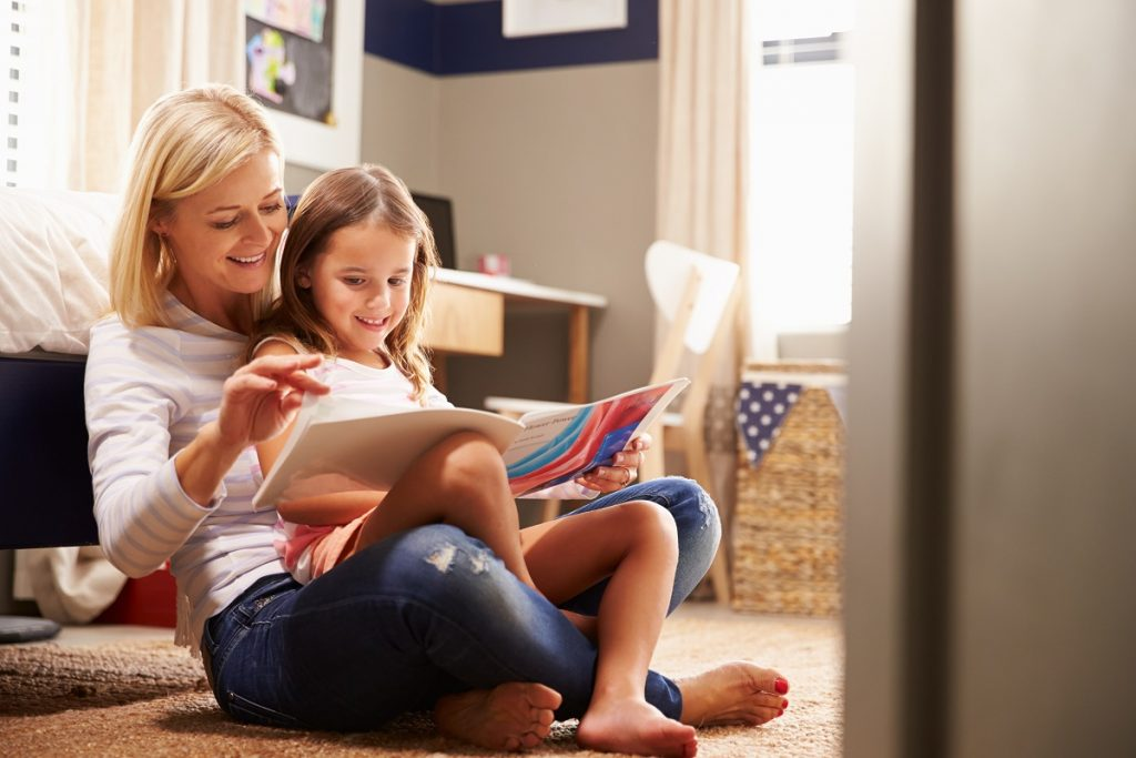 mother teaching her kid to read