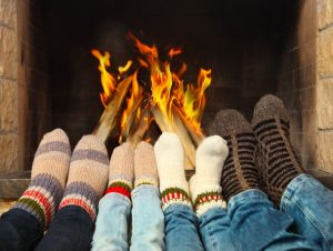 people warming their feet