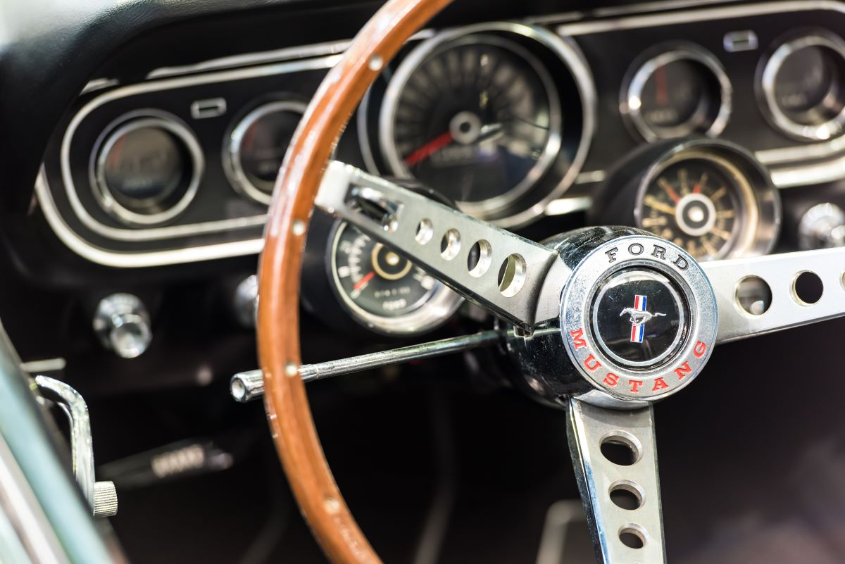 steering wheel and gauge cluster of a first generation ford mustang