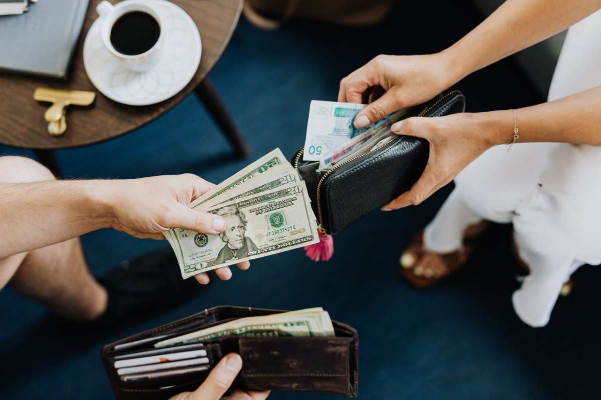 people holding cash