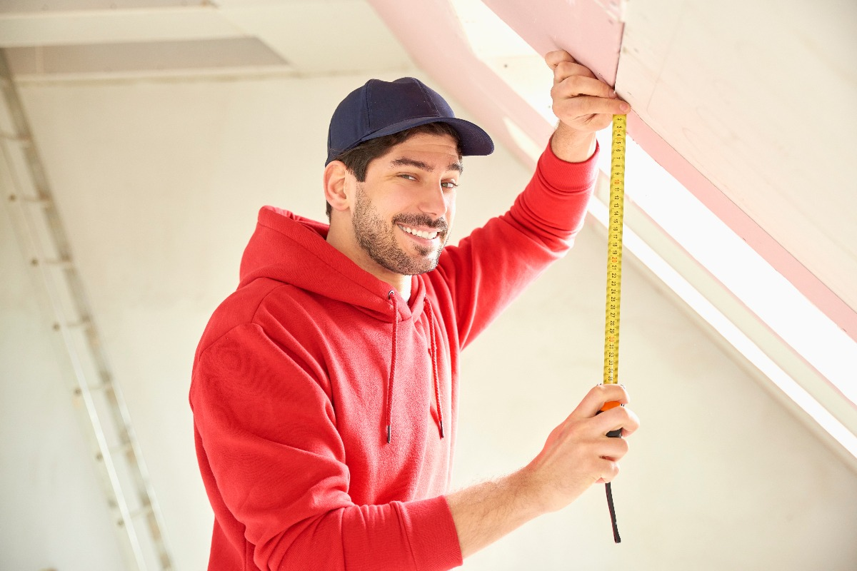 man holding a measuring tape