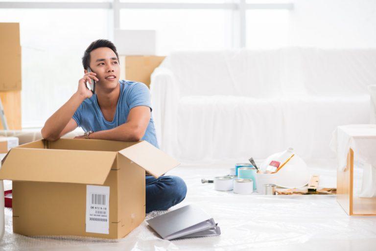 man calling resting on box