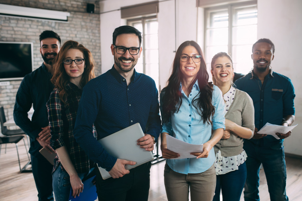 employees of a company standing together